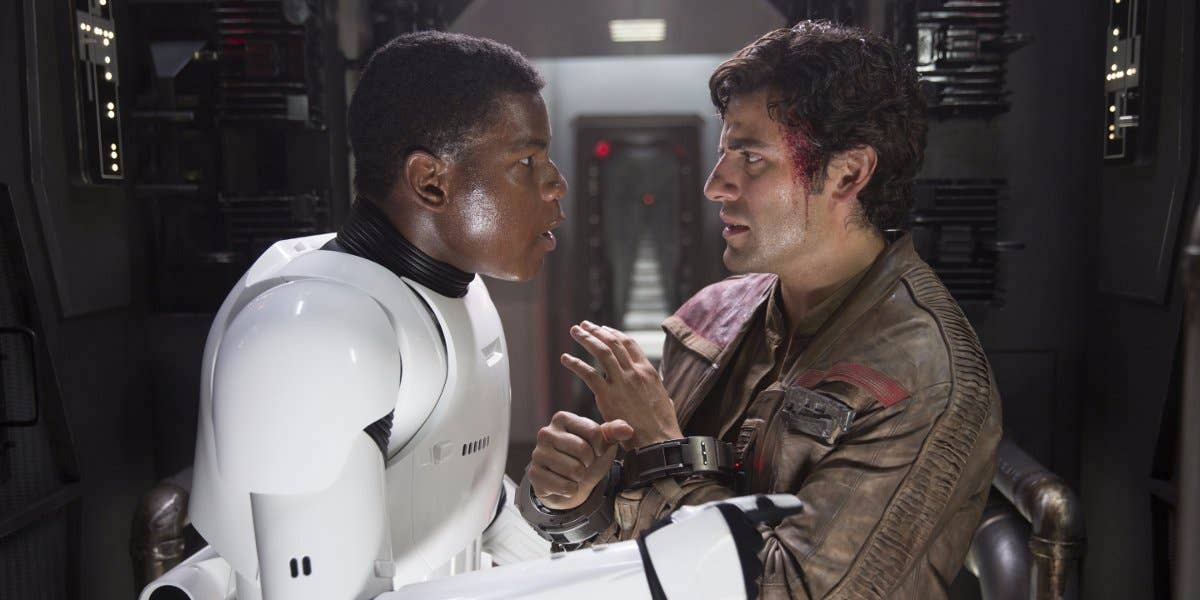John Boyega and Oscar Isaac in Finn and Poe in Star Wars: Force Awakens