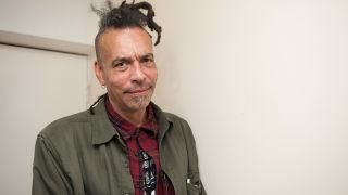 A portrait of Chuck Mosley looking into the camera