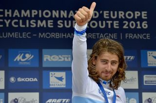 Slovakias Peter Sagan celebrates on the podium after winning the Mens Elite Race of the 2016 UEC Road European Championship on September 18 2016 in Plumelec western France