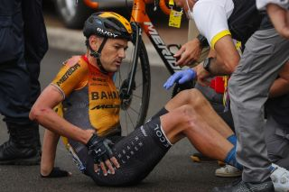 Bahrain McLaren's Rafael Valls received medical attention after crashing on the opening stage of the 2020 Tour de France