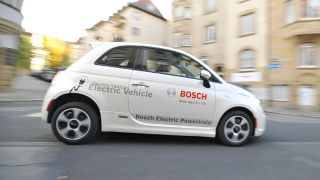 Mass adoption of electric cars could halve transport emissions by 2050