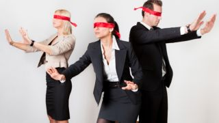 Blindfolded business people