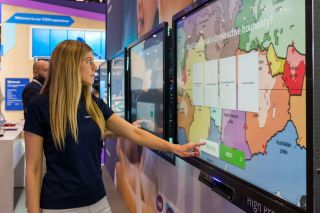 Teen girl touches clevertouch plus display