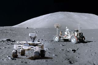 An artist's illustration of a PTScientists Audi Quattro rover exploring the moon near NASA's Apollo 17 lunar rover. The moon will get a 4G mobile phone network to connect the rover and its twin to a PTScientists lander.