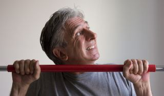 older man doing chin-ups