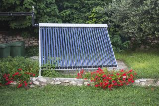 a vacuum solar thermal panel in a garden