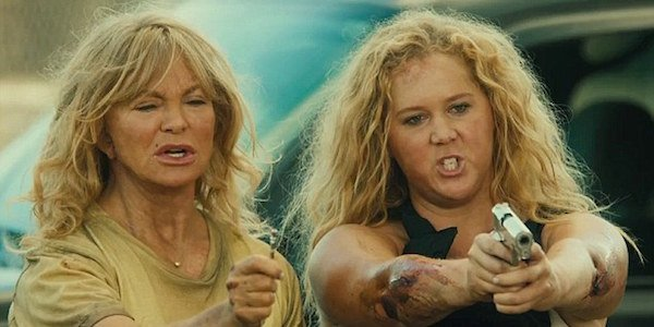 Goldie Hawn and Amy Schumer with weapons in Snatched