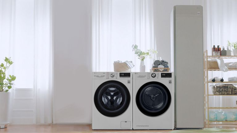 LG washing machines in a white laundry room