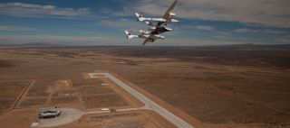 WhiteKnightTwo and SpaceShipTwo over Spaceport America in New Mexico