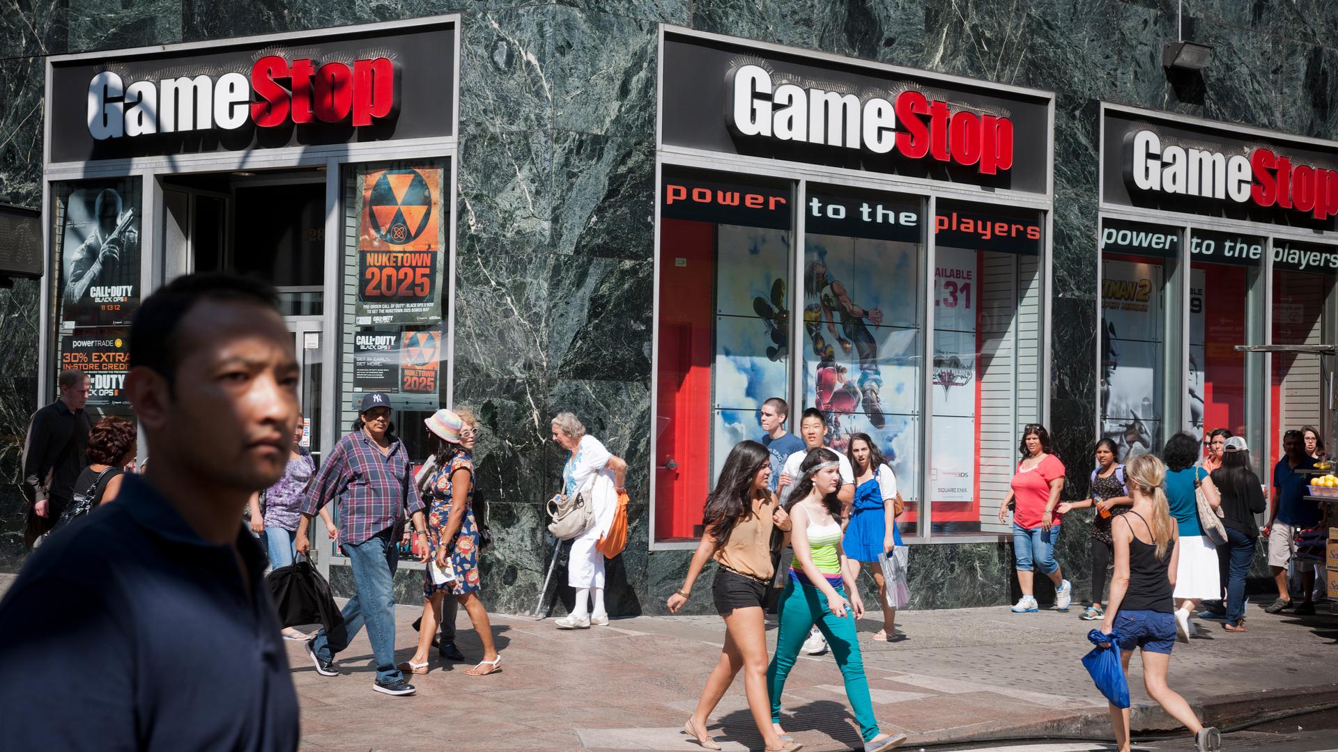 GameStop in store with people walking