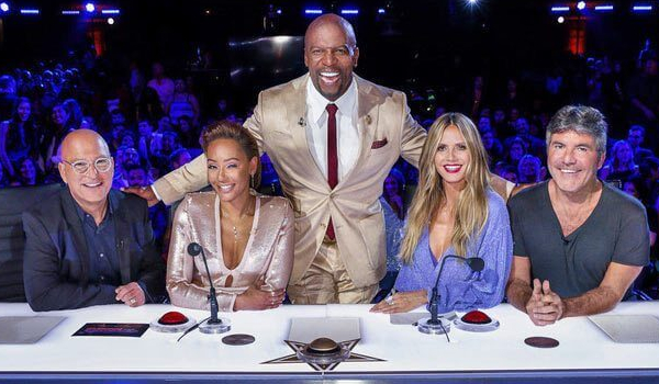 America's Got Talent: The Champions Terry Crews smiles as he stands behind the judges