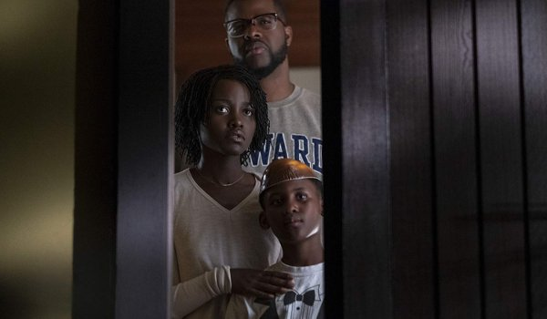 Us Lupita N'yongo Winston Duke Evan Alex looking out their window at the family in the driveway