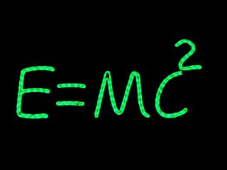 Einstein's famous equation, E=mc2, written on a chalkboard