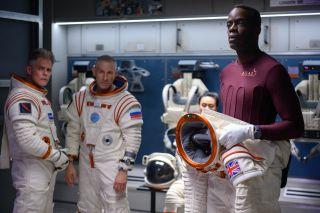 "From left, Martin Cummins, Mark Ivanir and Ato Essandoh in ""Away"" on Netflix."