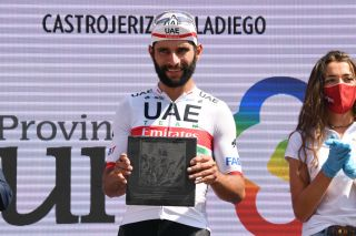 VILLADIEGO SPAIN JULY 29 Podium Fernando Gaviria Rendon of Colombia and UAE Team Emirates Celebration Trophy during the 42nd Vuelta a Burgos 2020 Stage 2 a 168km stage from Castrojeriz to Villadiego VueltaBurgos on July 29 2020 in Villadiego Spain Photo by David RamosGetty Images