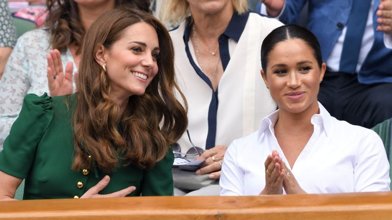 Kate Middleton and Meghan Markle in the Royal Box on Centre Court during day twelve of the Wimbledon Tennis Championships at All England Lawn Tennis and Croquet Club on July 13, 2019