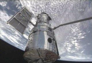 Astronauts Begin Spacewalk Marathon to Fix Hubble