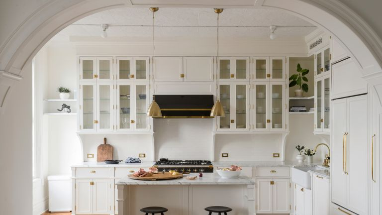 White kitchen with interior arches