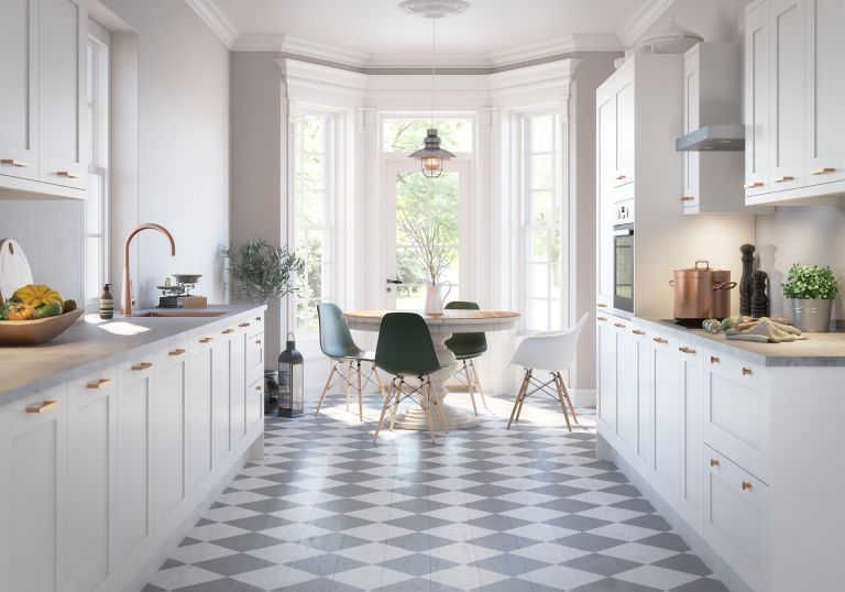 white kitchen with checkered black and white floor and large, light giving windows by magnet