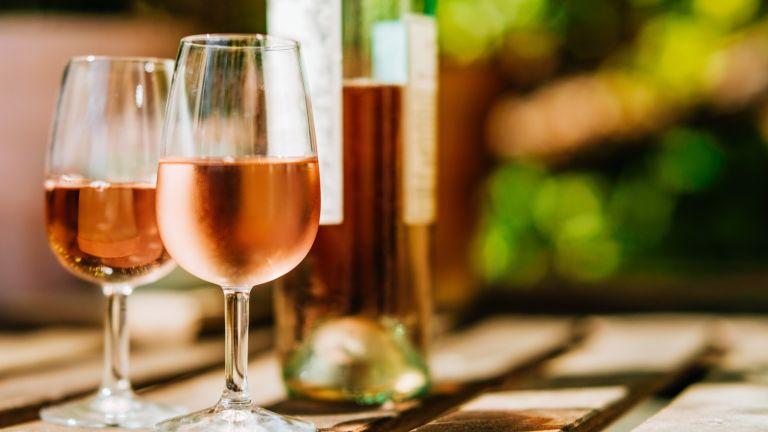 wine glasses and bottle in sunlight