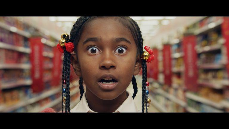 Little girl looking amazed in a Tesco store