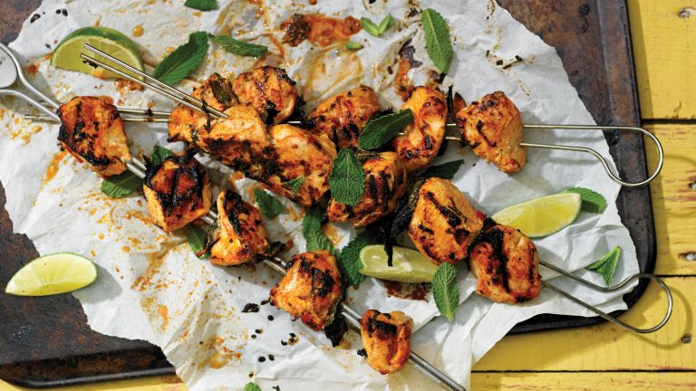 Barbecued chicken kebabs on skewers