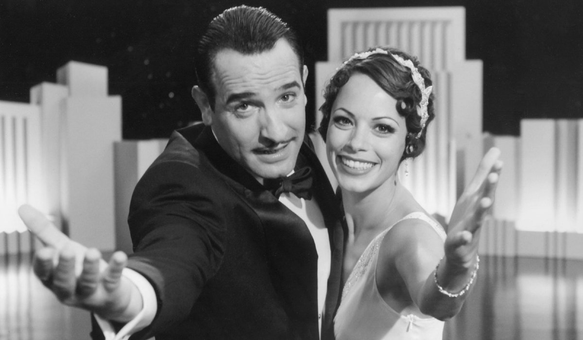 Jean Dujardin and Bérénice Bejo throw their arms out to the audience in The Artist.