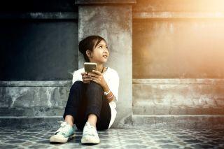 Asian girl on smartphone.