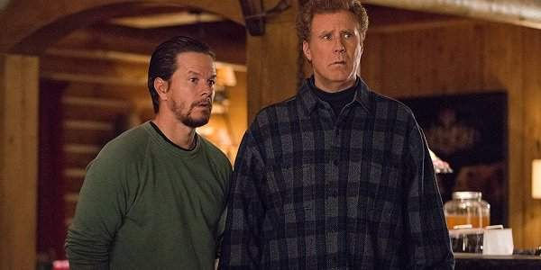 Daddy's Home 2 Mark Wahlberg and Will Ferrell look on in fright at something in their cabin