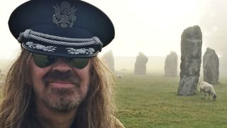 Julian Cope with a sheep and a stone formation