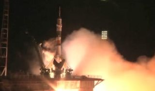 Soyuz Launches And Docks With International Space Station