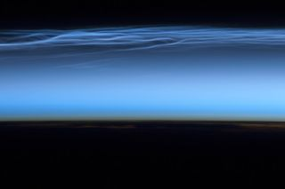 Polar mesopheric clouds captured by astronaut on international space station.