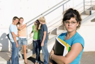 shy teen girl next to popular students