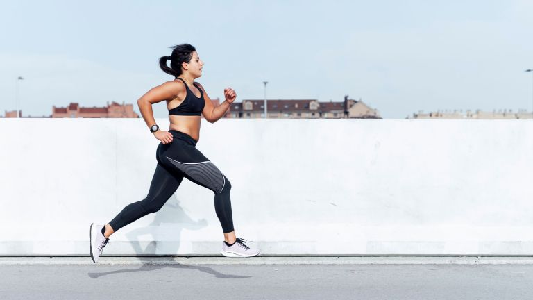 Young woman running training in the city