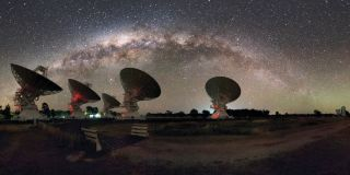Astronomers used the CSIRO Compact Array in Australia, shown here with the Milky Way overhead, to detect strange plasma lenses shaped like noodles in the space between the stars of our galaxy.