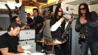 Korn perform on airplane traveling from London to New York for contest winners and US Troops in November, 2005