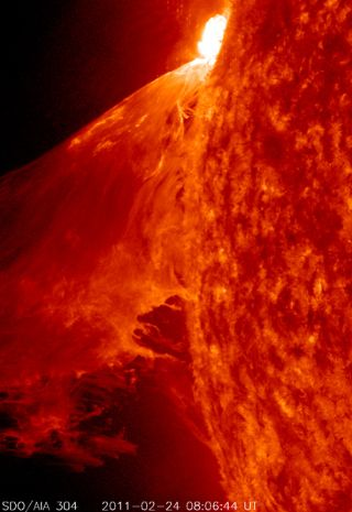 "NASA's Solar Dynamics Observatory captured this view of a powerful M3.6 Class solar flare on Feb. 24, 2011 during a 90-minute sun storm. NASA scientists called the display a ""monster prominence"" that kicked up a huge plasma wave."