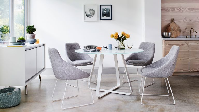 grey fabric chair and white table dining set by furniture village