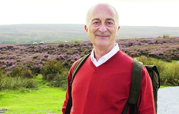 Tony Robinson heaves on his backpack for the final leg of his 190-mile journey across England.