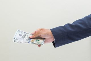 A businessman holding money in his hand.