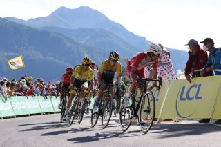 Guillaume Martin (Cofidis) leads eventual stage winner Primoz Roglic (Jumbo-Visma) and overall race leader Julian Alaphilippe (Deceuninck-QuickStep) into the final few hundred metres of stage 4 of the 2020 Tour de France at Orcières-Merlette