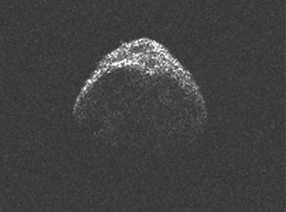 A radar image of asteroid 2012 LZ1, which flew past Earth beyond the orbit of the moon.