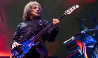 Geezer Butler performs with Black Sabbath on Day 1 of Lollapalooza, Aug 3, 2012