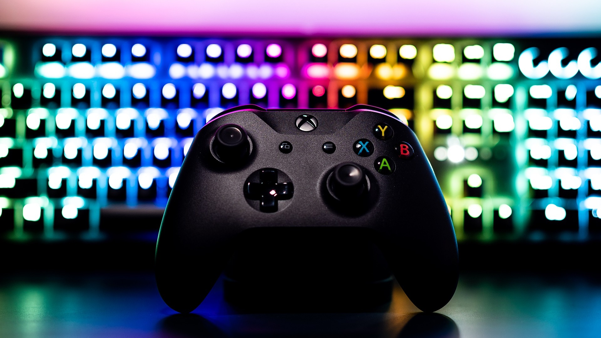 XBOX Controller in front of an RGB keyboard