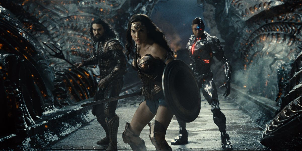 Aquaman, Wonder Woman, and Cyborg lined up inside Steppenwolf's lair in Zack Snyder's Justice League .
