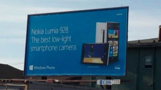 Nokia Lumia 928 appears on a billboard no part of cat left in bag