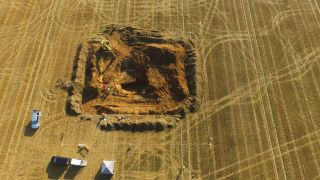 An aerial view of the crater from the explosion of the V2 rocket in 1944 being excavated last month. The site was an orchard when the rocket hit it 77 years ago.
