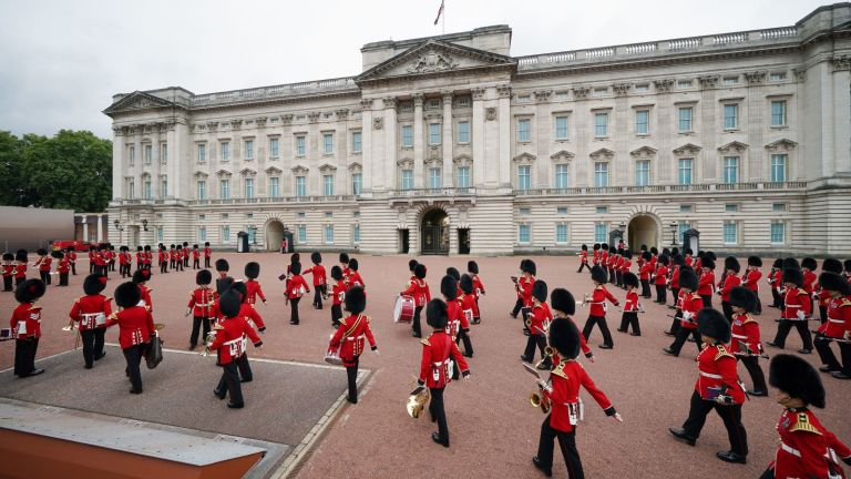 Members of the Nijmegen Company Grenadier Guards and the 1st Battalion the Coldstream Guards take part in the Changing of the Guard, which is taking place for the first time since the start of the coronavirus pandemic in London on August 23, 2021. (Photo by Yui Mok / POOL / AFP) (Photo by YUI MOK/POOL/AFP via Getty Images)