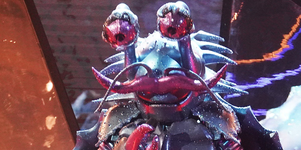 The Crab looking down The Masked Singer Fox