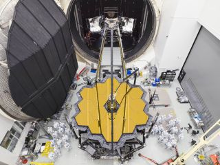 NASA engineers pose with the James Webb Space Telescope shortly after its emergence from Chamber A, a giant vacuum testing chamber at the Johnson Space Center in Houston, on Dec. 1, 2017.